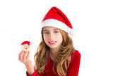 Christmas kid girl holding Xmas Santa cookie