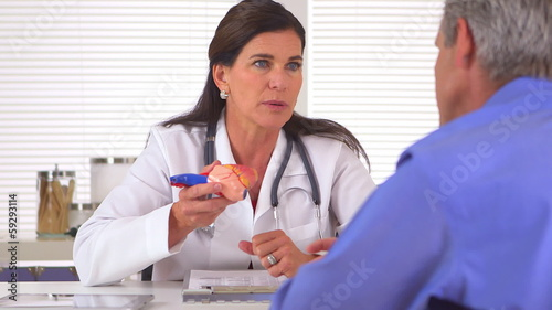Doctor reviewing medical history with patient