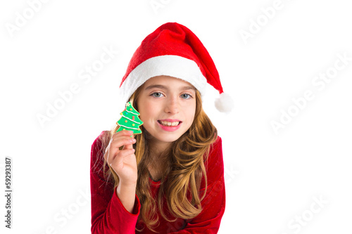 Christmas kid girl holding Xmas tree cookie