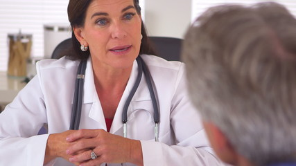 Doctor advising male patient on how to have a healthier life