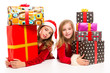 Christmas Santa kid girls with many gifts stacked