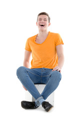 Young man laughing out loud, on white background