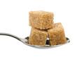 Three brown sugar cubes on spoon