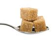 Three brown sugar cubes on spoon