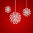 Christmas red background with hanging ornamental snowflake shape