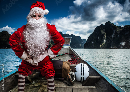 Santa Claus pose on asian boat.
