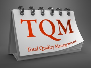 Desktop Calendar with TQM Concept.