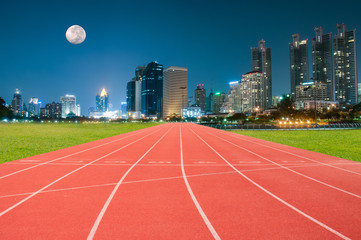 Athlete Track or Running Track and a city with illuminated build