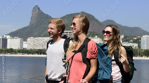 Group of tourist in  Rio de Janeiro with Christ the Redeemer .