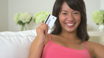 Close up of Asian woman holding credit card