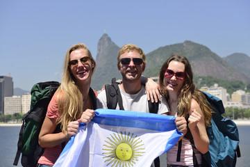 Sport fans at Rio de Janeiro holding Argentinian flag