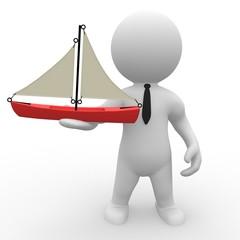Mann mit Miniatur-Schiff