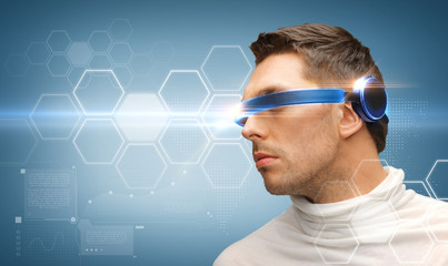 serious man with futuristic glasses