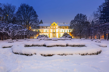 Winter scenery of Abbots Palace in snowy park of Gdansk, Poland
