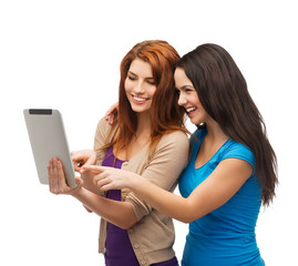 two smiling teenagers with tablet pc computer
