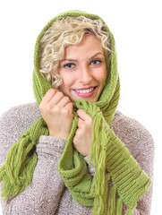 Portrait of a smiling woman wrapped with wool scarf and cap