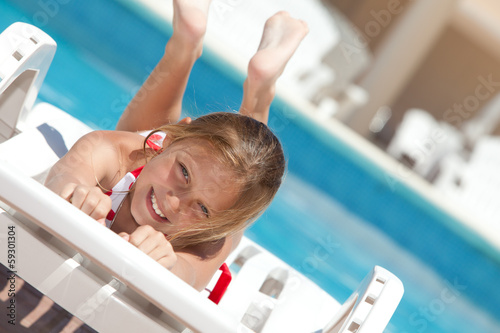 happy girl by the swimming pool