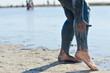 Woman applying mineral blue mud on legs at Sivash lake