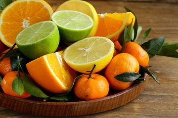 different types of citrus fruits (orange, lime, lemon)