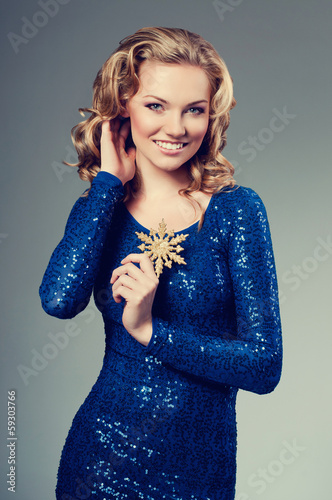 attractive young brunette girl with shining dress and snow flake