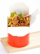 Chinese noodles with vegetables and meat in cardboard box