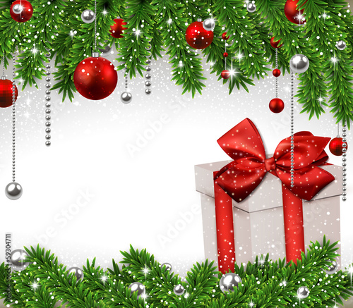 Christmas background with fir branches and gift box.