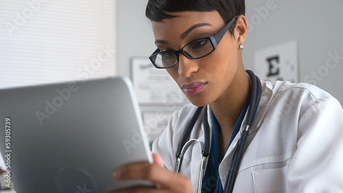Doctor using tablet pc and laptop computer