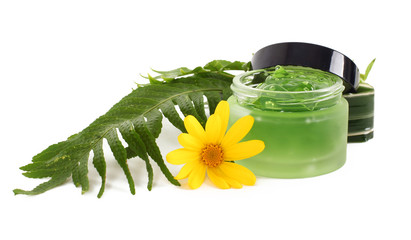 Cosmetics cream in the green jar