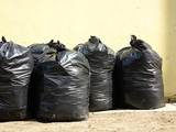 Pile of full black garbage bags