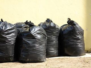 Pile of full black garbage bags