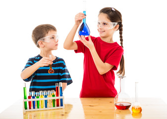 Two kids making chemical experiment