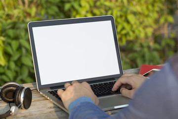 Person working on laptop in a park