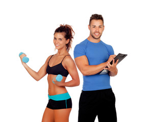 Handsome personal trainer with beautiful girl with dumbbells