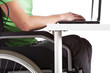 Disabled man sitting at a desk