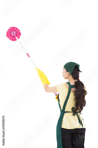 Young housewife cleaning by mop