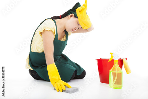 tired Service woman cleaning the floor