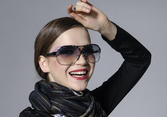 portrait of gorgeous young smile lady in sunglasses