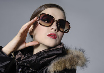 beautiful young woman with make-up with sunglasses