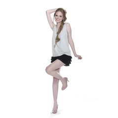 girl in leisure clothing and shorts posing in studio