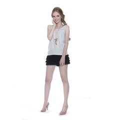 full-length young girl in leisure clothing posing in studio