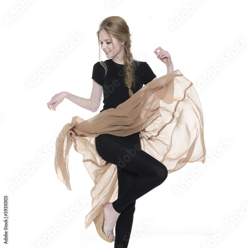 Elegant young girl dances in a black dress over white background