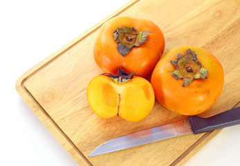 Fresh ripe persimmon on a wood