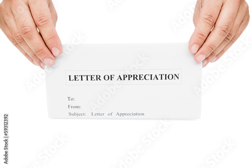 hands holding a letter of appreciation with clipping path