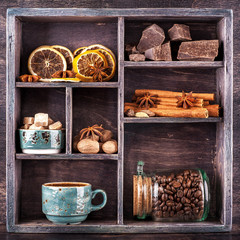 Coffee, chocolate and spices in a wooden   vintage box