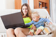 mother with baby working online