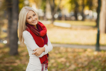 Portrait of very beautiful young woman in autumn park