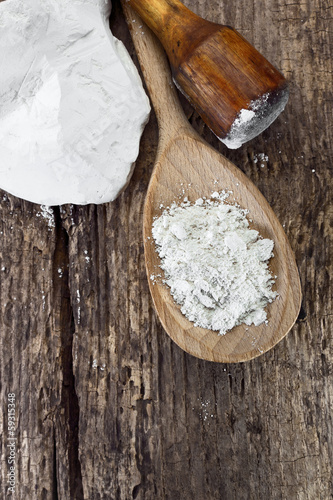 Natural chalk pounded in a wooden spoon