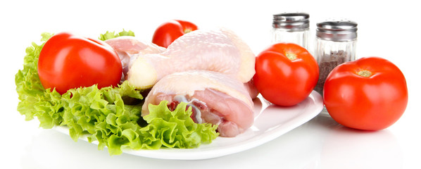 Raw chicken legs isolated on white