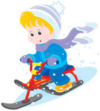 Child on a snow scooter
