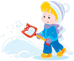 Child with a small snow shovel
